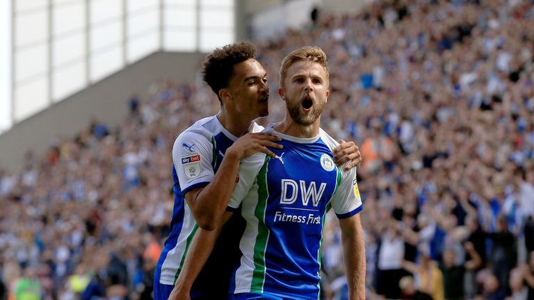 Wigan Athletic's Michael Jacobs (right) celebrates with teammate Antonee Robinson