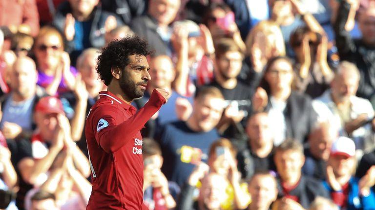 Mohamed Salah celebrates scoring Liverpool's winning goal against Brighton