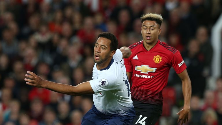 Mousa Dembele and Jesse Lingard battle for the ball in midfield