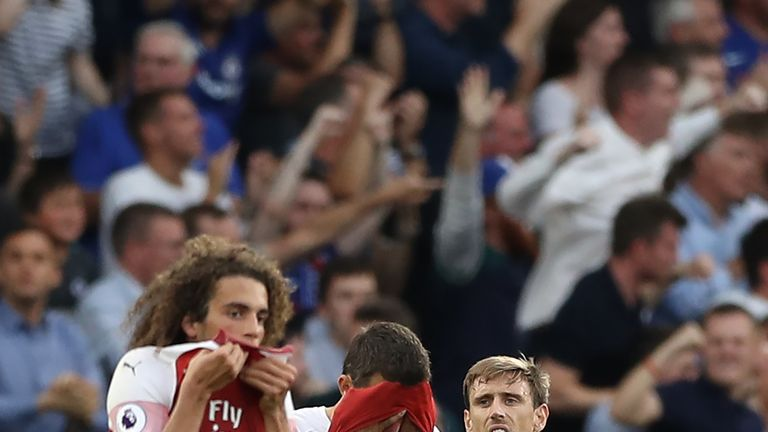 Matteo Guendouzi and Nacho Monreal react during Arsenal's defeat to Chelsea