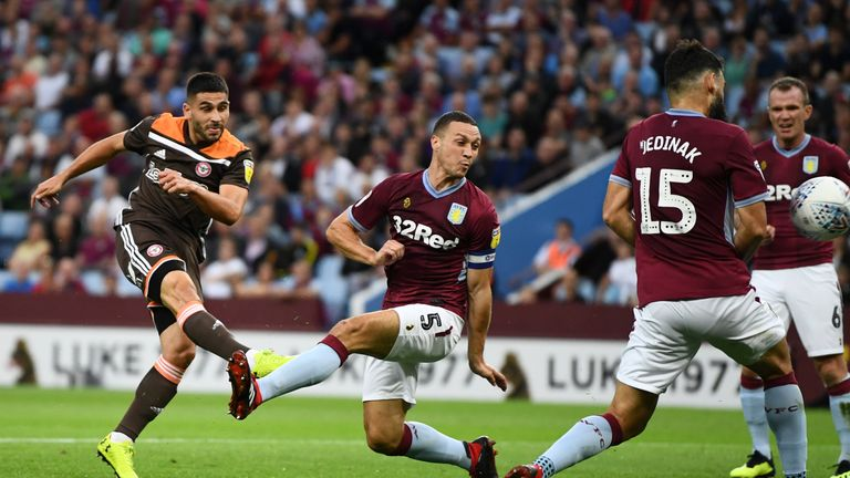 Neal Maupay scoring for Brentford against Aston Villa