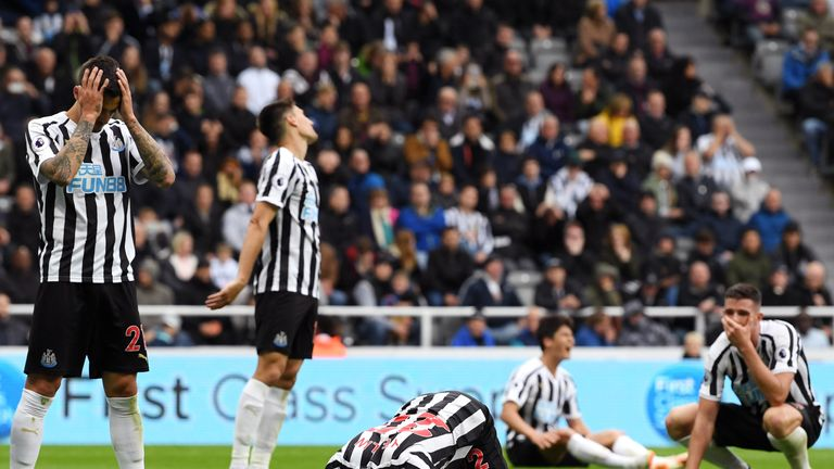Newcastle players are distraught after conceding Chelsea's late winner