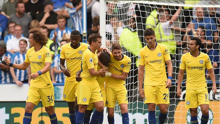 N'Golo Kante (C) celebrates with teammates after scoring the team's first goal