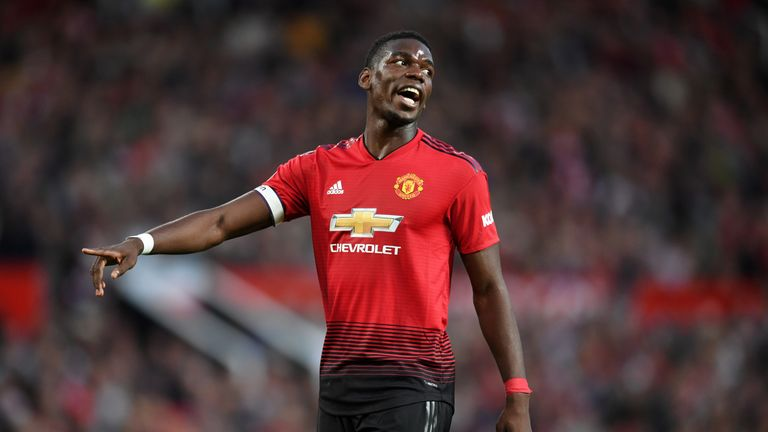 Paul Pogba scored a penalty and captained Manchester United to a 2-1 win against Leicester City at Old Trafford