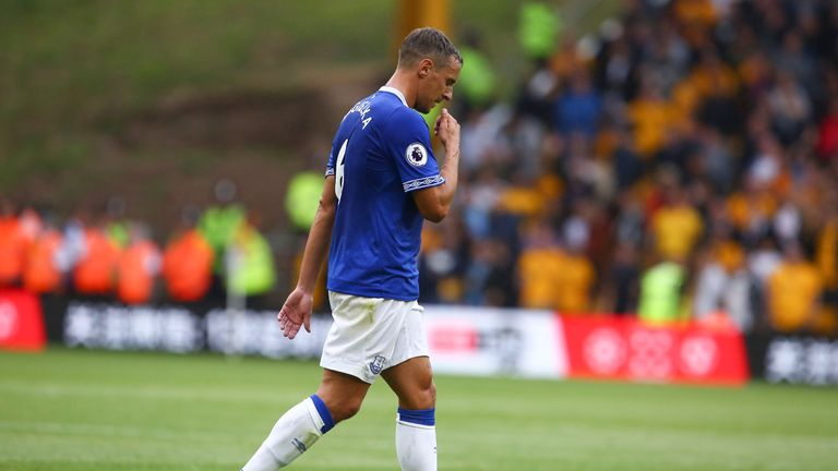 Phil Jagielka leaves the pitch after being sent off for a challenge on Diogo Jota