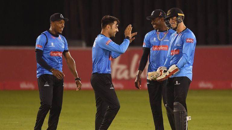 Rashid Khan's 3-24 spun Sussex Sharks to a crucial win over Gloucestershire at Bristol