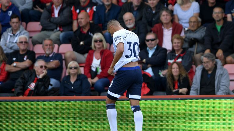 Richarlison walks from the pitch after being sent off at the Vitality Stadium