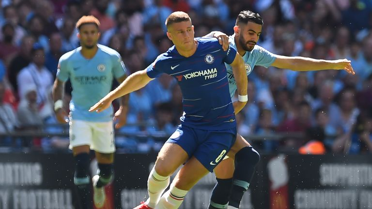 Ross Barkley holds off the challenge of Riyad Mahrez in the Community Shield