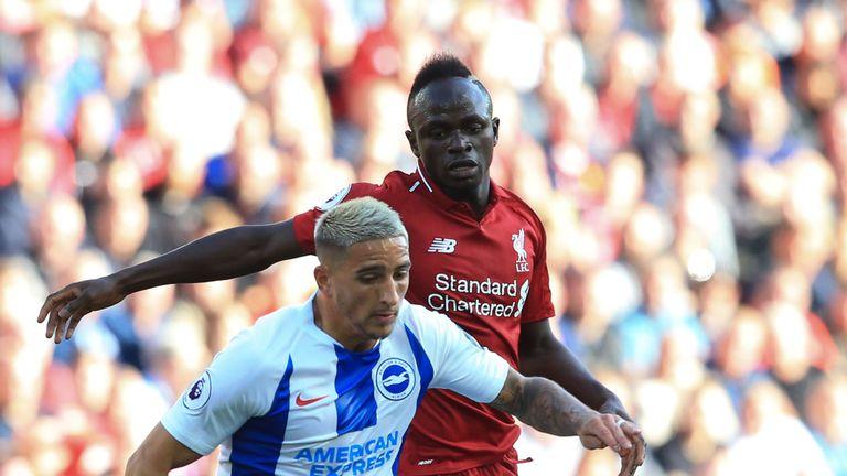 Sadio Mane puts pressure on Anthony Knockaert at Anfield