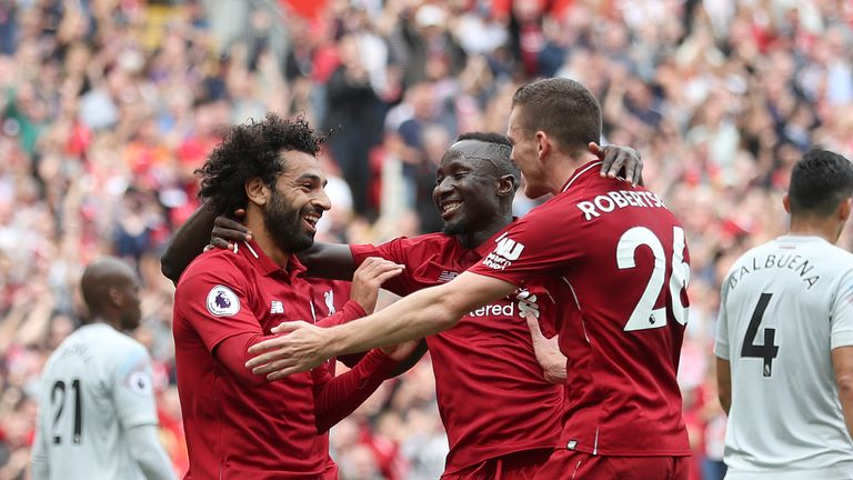 Naby Keita celebrates with his new Liverpool team-mates