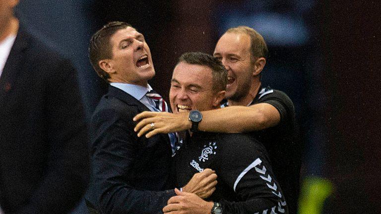Steven Gerrard celebrates Rangers' opener with his coaching staff