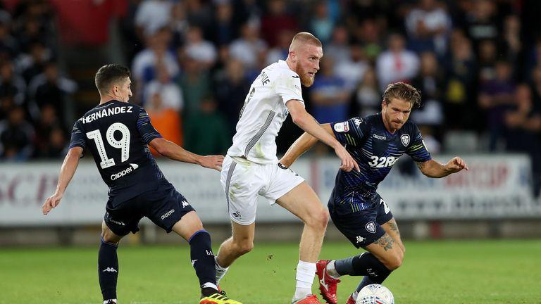 Pablo Hernandez's equaliser earned a point for Leeds after Oliver McBurnie's double