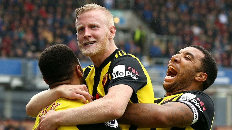 Will Hughes of Watford celebrates with teammates after scoring his team's third goal during the Premier League match between Burnley FC and Watford FC at Turf Moor on August 19,