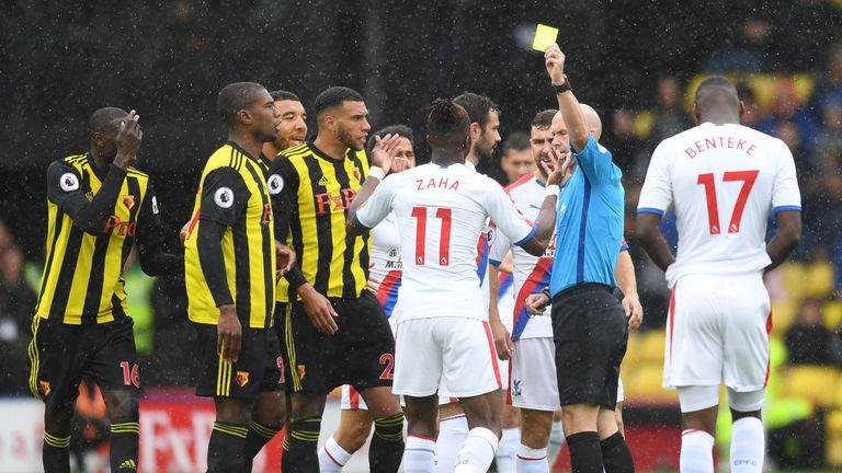 Wilfried Zaha is shown a yellow card at Watford