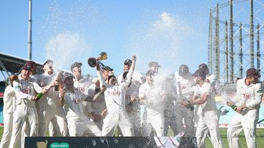 Surrey captain Rory Burns lifts the County Championship trophy