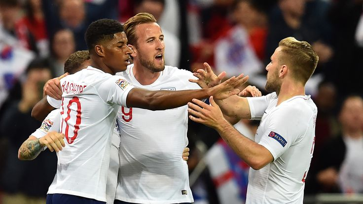 England's striker Marcus Rashford (2nd L) celebrates with teammates after scoring the opening goal of the UEFA Nations League football match between England and Spain at Wembley Stadium in London on September 8, 2018.
