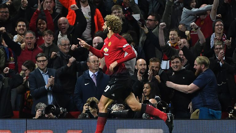 Marouane Fellaini celebrates his stoppage-time equaliser