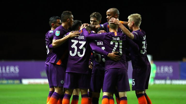 City players celebrate Jesus' opening goal