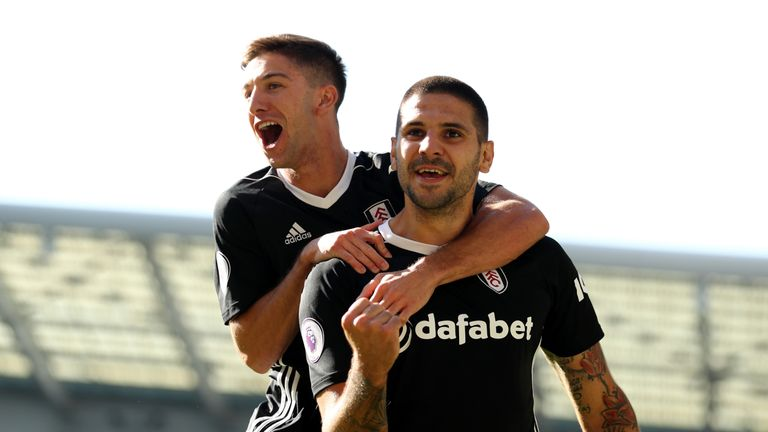 Aleksandar Mitrovic celebrates with Fulham teammate Luciano Vietto