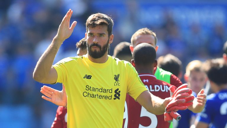 Alisson salutes the Liverpool fans after his error at Leicester