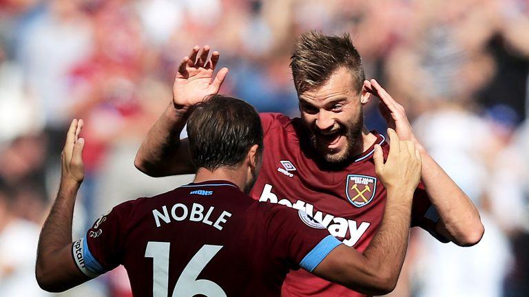 Andriy Yarmolenko celebrates his goal with Mark Noble