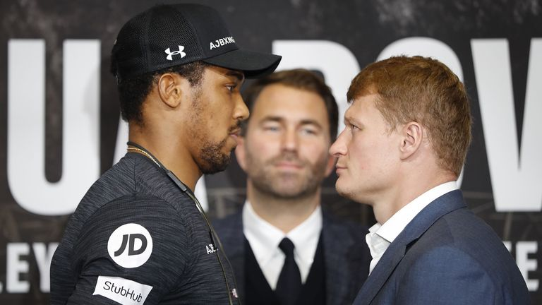 Anthony Joshua weighs in nearly  two stone heavier than Alexander Povetkin