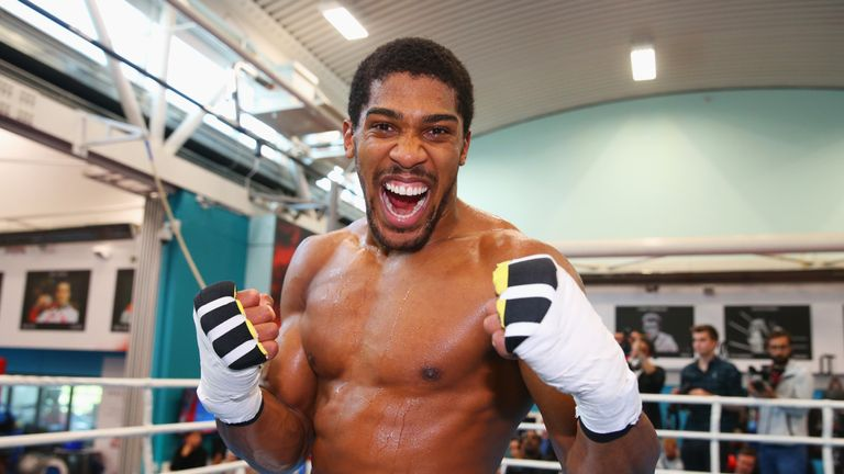 Anthony Joshua hits the gym before enjoying a game of Risk