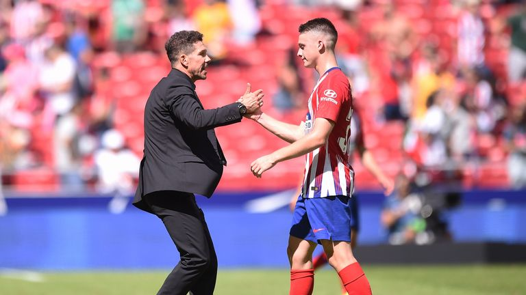Borja Garces is congratualted by Diego Simeone after his late equaliser for Atletico Madrid
