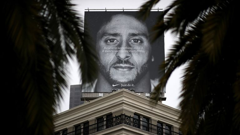 A billboard featuring former 49ers quarterback Colin Kaepernick is displayed on the roof of the Nike Store in San Francisco