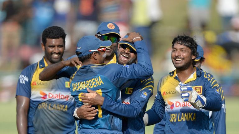 Sri Lanka players celebrate Lahiru Thirimanne's run-out of Jos Buttler at Kandy