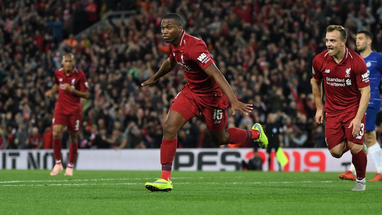 Liverpool's English striker Daniel Sturridge celebrates scoring the opening goal during the English League Cup third round football match between Liverpool and Chelsea at Anfield in Liverpool, north west England on September 26, 2018. (Photo by Paul ELLIS / AFP) / RESTRICTED TO EDITORIAL USE. No use with unauthorized audio, video, data, fixture lists, club/league logos or 'live' services. Online in-match use limited to 120 images. An additional 40 images may be used in extra time. No video emulation. Social media in-match use limited to 120 images. An additional 40 images may be used in extra time. No use in betting publications, games or single club/league/player publications. /         (Photo credit should read PAUL ELLIS/AFP/Getty Images)