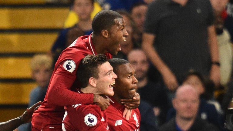 Daniel Sturridge celebrates with team-mates after scoring the team's first goal during the English Premier League football match between Chelsea and Liverpool at Stamford Bridge in London on September 29, 2018