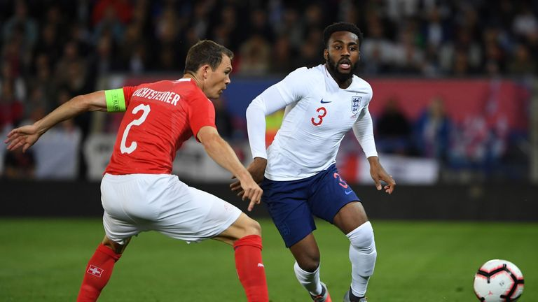 Danny Rose and Stephan Lichsteiner in action during England v Switzerland
