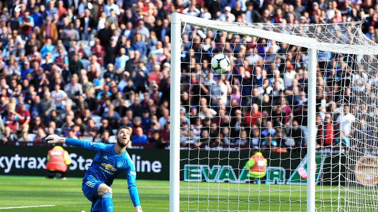 David De Gea watches Andriy Yarmolenko's shot cross the line for 2-0