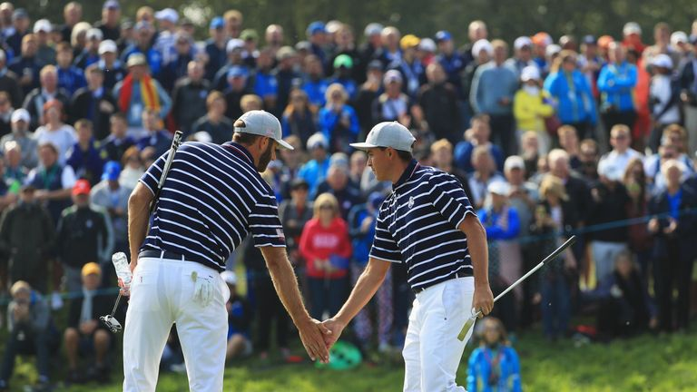 Dustin Johnson and Rickie Fowler put the first point on the board for USA