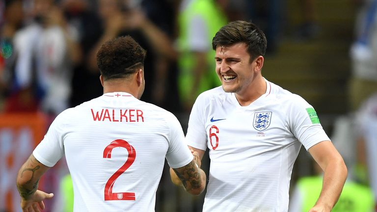 Kyle Walker of England and Harry Maguire of England celebrate after teammate Kieran Trippier scores their team's first goal during the 2018 FIFA World Cup Russia Semi Final match between England and Croatia at Luzhniki Stadium on July 11, 2018 in Moscow, Russia.