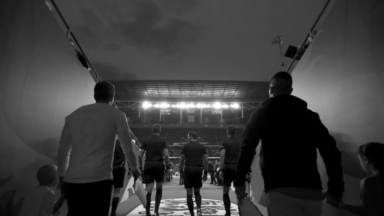 Match Officials and teams walk out to the pitch ahead of the UEFA Nations League A group four match between England and Spain