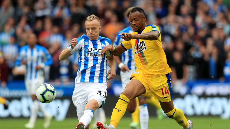 Huddersfield Town's Florent Hadergjonaj (left) and Crystal Palace striker Jordan Ayew battle for the ball