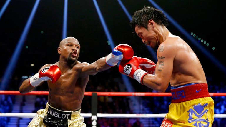Floyd Mayweather Jr. throws a right at Manny Pacquiao during their welterweight unification championship bout on May 2, 2015 at MGM Grand Garden Arena in Las Vegas, Nevada.