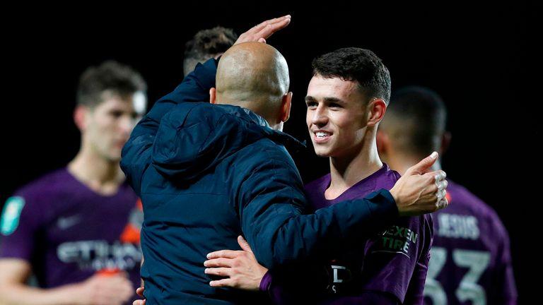 Pep Guardiola congratulates Phil Foden following Man City's 3-0 win at Oxford