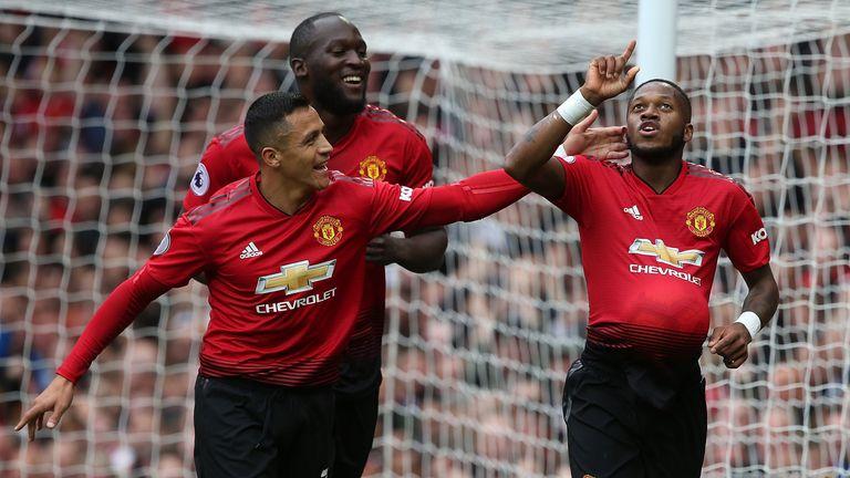 Fred celebrates his goal with Alexis Sanchez and Romelu Lukaku
