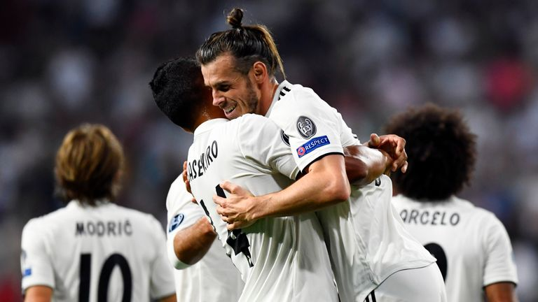 Real Madrid's Welsh forward Gareth Bale celebrates scoring his team's second goal during the UEFA Champions League group G football match between Real Madrid CF and AS Roma at the Santiago Bernabeu stadium in Madrid on September 19, 2018.