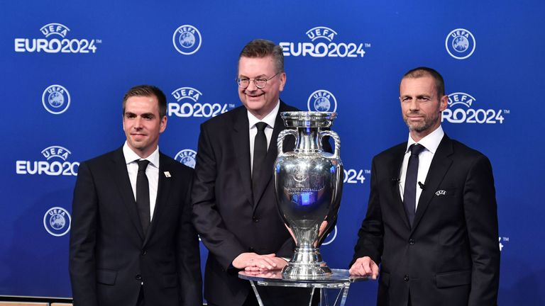 Head of Germany's bid to host the Euro 2024 Philipp Lahm (L), DFB president Reinhard Grindel (C) and UEFA president Aleksander Ceferin (R) pose with the UEFA Euro trophy
