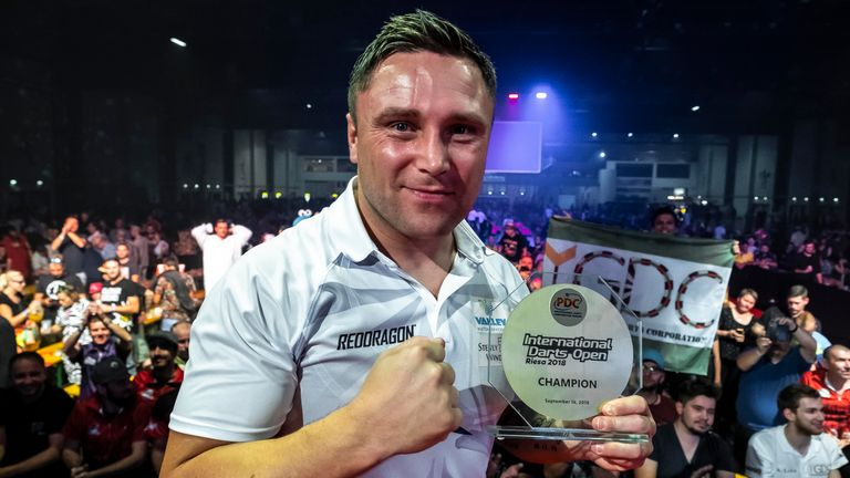 Gerwyn Price claimed the International Darts Open with victory over Simon Whitlock