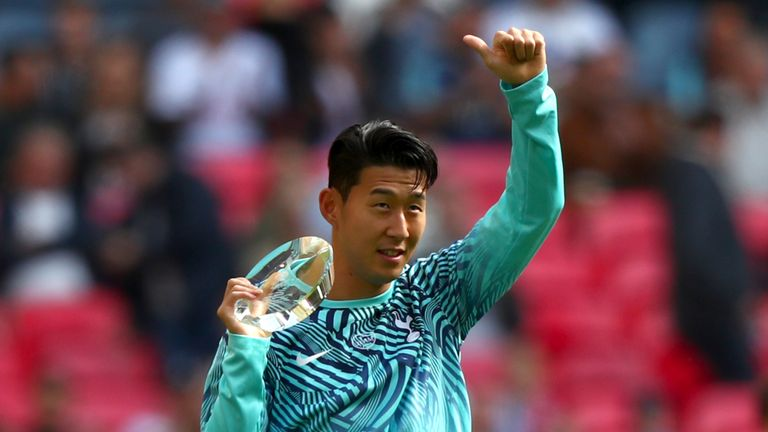 The South Korean presents his medal to the Tottenham fans at Wembley