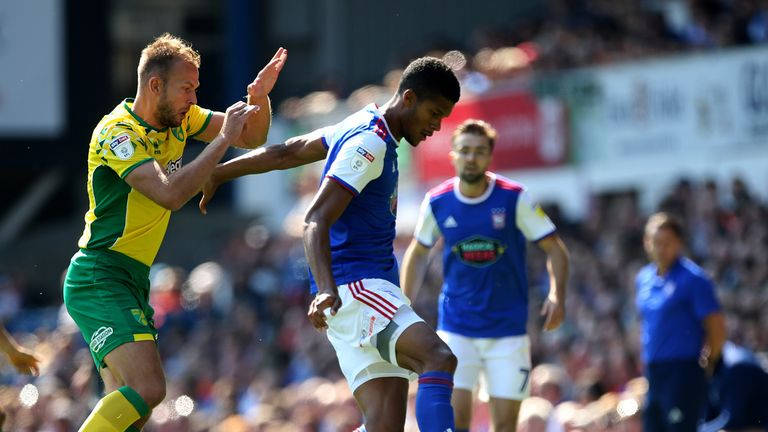Ipswich Town's Jordan Spence (right) and Norwich City's Jordan Rhodes battle for the ball at Portman Road