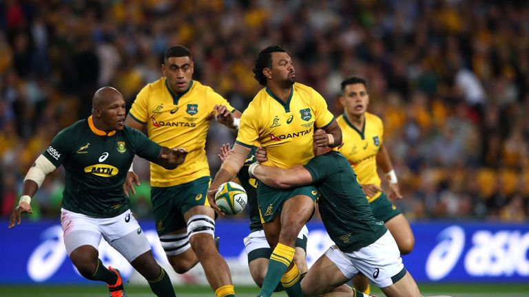 Australia's Kurtley Beale offloads the ball in the tackle