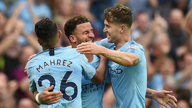 Kyle Walker celebrates his goal with Riyad Mahrez and John Stones