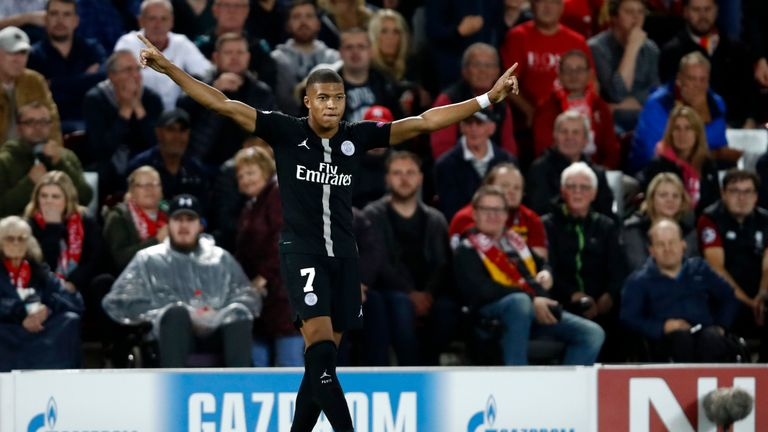 PSG striker Kylian Mbappe celebrates one of his four goals against Lyon