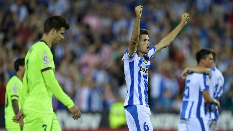 Leganes' Spanish midfielder Gerard Gumbau celebrates defeating Barcelona